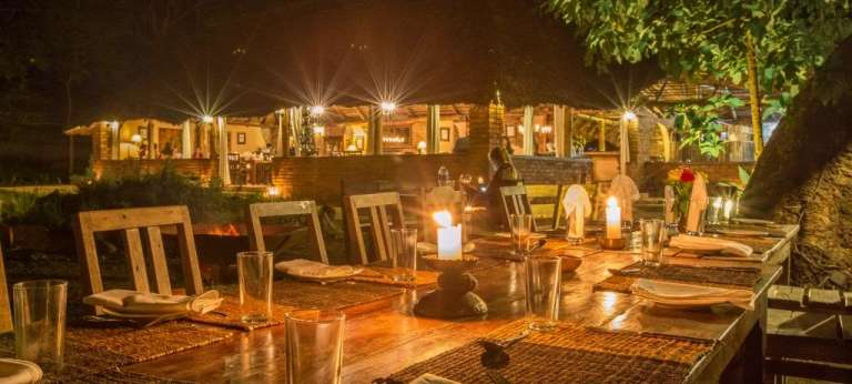 Dining at night at Rivertrees, Tanzania