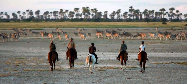 Guests Horse Riding at Camp Kalahari, Botswana
