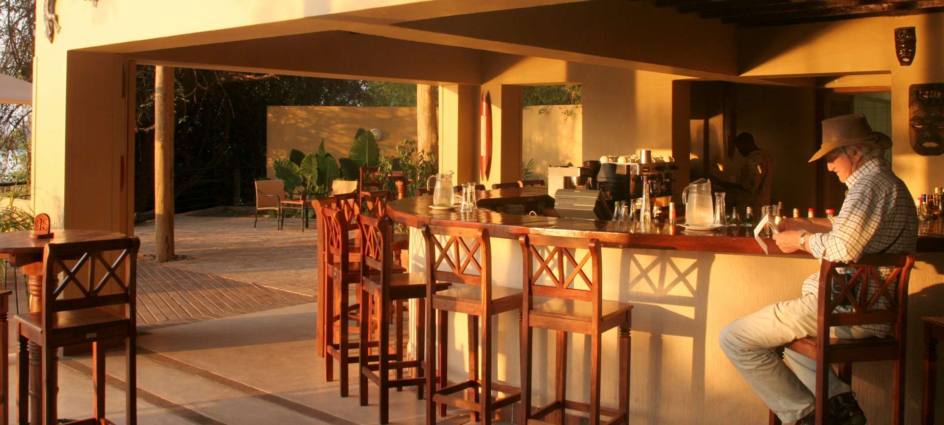 Savour a sundowner at Chobe Safari Lodge