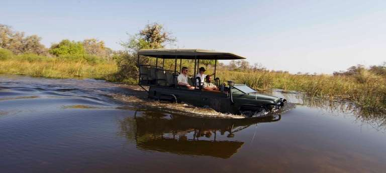 Xakanaxa Camp Game Drive Through Water