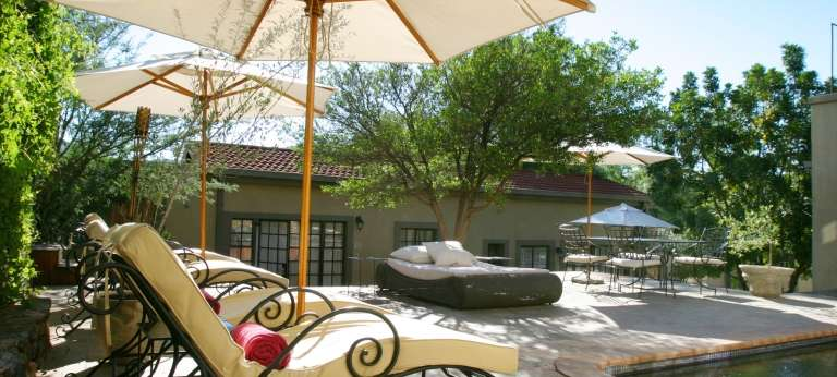 the pool area at Olive Grove Guest House,  Namibia