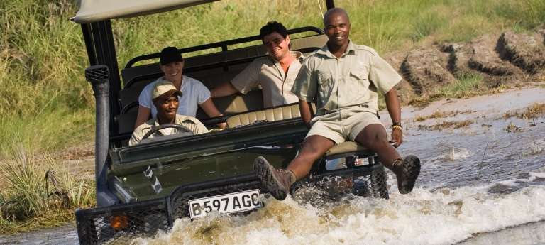 An African game drive safari at Sandibe Okavango Safari Lodge, Okavango Delta, Botswana