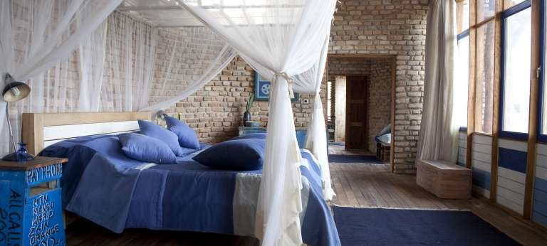 Volcanoes Kyambura Lodge Bedroom in Uganda