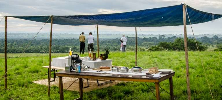 Guests enjoying the Landschape at Ishasha Wilderness Camp in Uganda