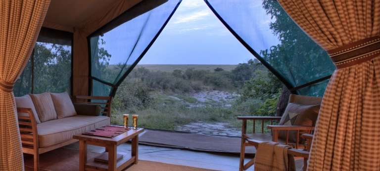 The guest tent seating view at Rekero Mara Camp, Kenya