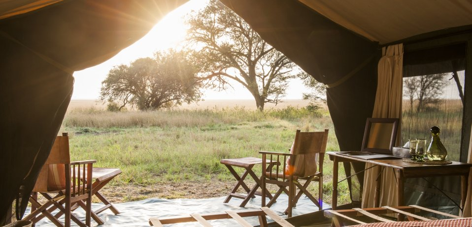 Nomad serengeti safari camp tanzania wildebeest migration