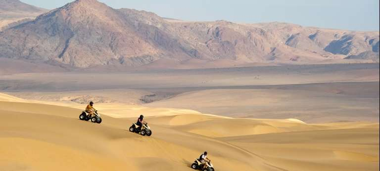 Quad biking through the dunes is a popular activity during August