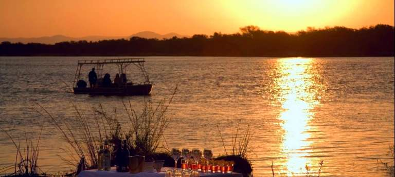 Boat at sunset | Luxury Zambian Odyssey (7 days)
