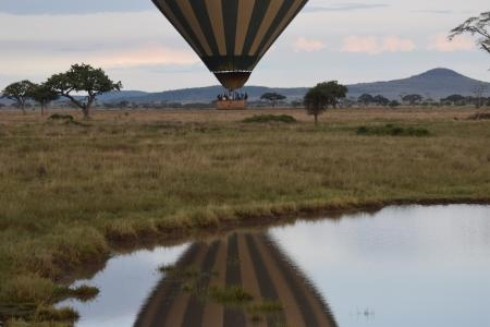 The reflection of the hot air balloon